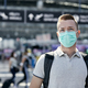 Man wearing protective face at airport terminal - PhotoDune Item for Sale