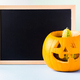 Halloween carved squash and black board - PhotoDune Item for Sale