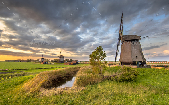 Three Traditional wooden windmills - Stock Photo - Images