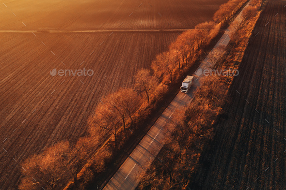 Aerial view of semi-truck on the road in sunset, drone pov - Stock Photo - Images
