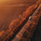 Aerial view of semi-truck on the road in sunset, drone pov - PhotoDune Item for Sale