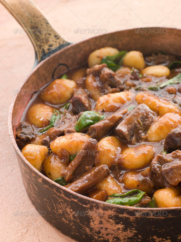 Oxtail Braised in Red Wine with Basil Gnocchi - Stock Photo - Images