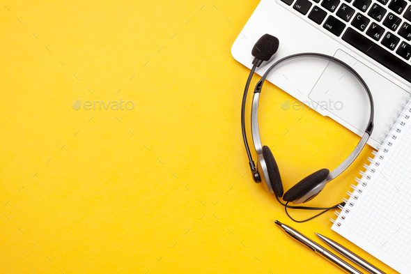 Office desk with headset and laptop. Work from home - Stock Photo - Images