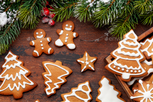 Christmas card with gingerbread cookies and fir tree - Stock Photo - Images