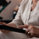 Close up of old woman hand using tablet screen display - PhotoDune Item for Sale