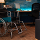 Empty living room with wheelchair and walking tools - PhotoDune Item for Sale
