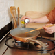Woman Cooking Breakfast - PhotoDune Item for Sale