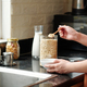 Woman Standing at Kitchen Counter - PhotoDune Item for Sale