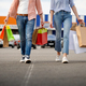 Man and woman with bags on supermarket car parking - PhotoDune Item for Sale