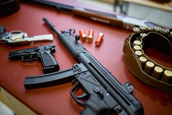 Automatic rifle and pistols in gun store closeup - Stock Photo - Images