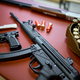 Automatic rifle and pistols in gun store closeup - PhotoDune Item for Sale