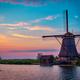 Windmills at Kinderdijk in Holland. Netherlands - PhotoDune Item for Sale