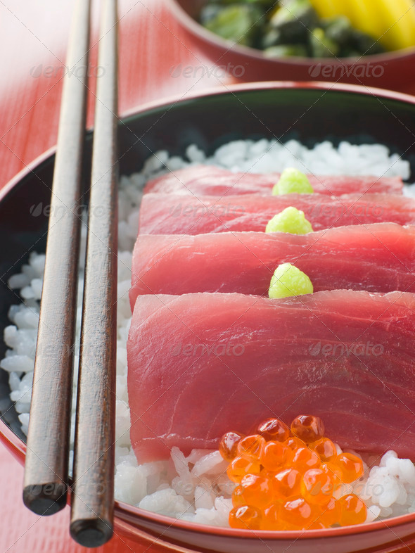 Sashimi of Yellow Fin Tuna on Rice with Salmon Roe Pickles and Wasabi - Stock Photo - Images