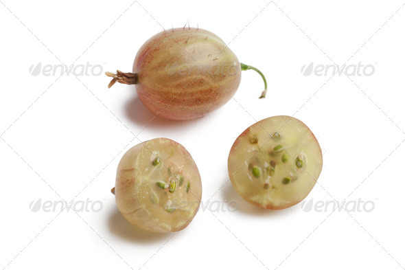 Whole and half fresh gooseberries - Stock Photo - Images