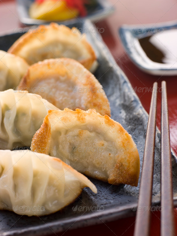 Fried Pork and Shrimp Dumplings with Soy Sauce - Stock Photo - Images