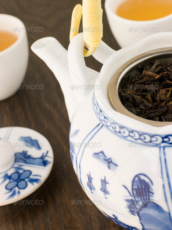 Green Tea leaves In a Tea pot with Cups - Stock Photo - Images