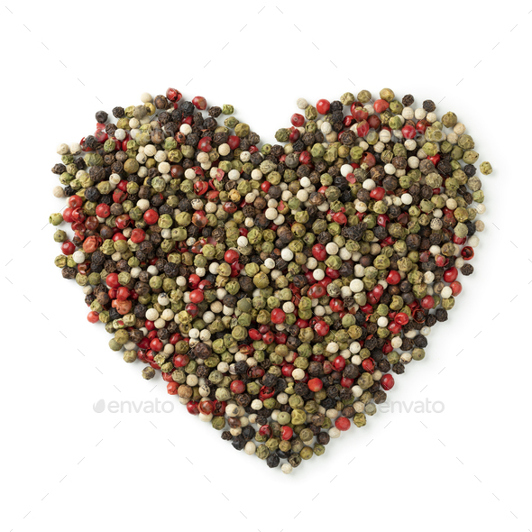 Mixture of peppercorns in heart shape isolated on white background - Stock Photo - Images