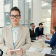 Businesswoman standing at office during meeting - PhotoDune Item for Sale