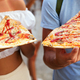 Couple eating pizza while traveling on vacation - PhotoDune Item for Sale