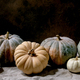Colorful pumpkins collection on linen tablecloth. Dark still life - PhotoDune Item for Sale