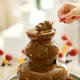 Fondue with a chocolate fountain and sweets for it.Sweet theme - PhotoDune Item for Sale