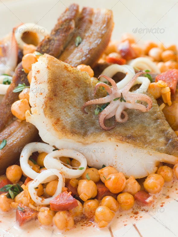 Pan Fried Cod Fillet and Baby Squid with Braised Belly Pork and Chick Peas - Stock Photo - Images