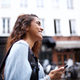 Side of young Indian woman walking in city with cellphone - PhotoDune Item for Sale