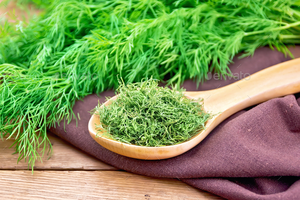 Dill dry in spoon on board - Stock Photo - Images
