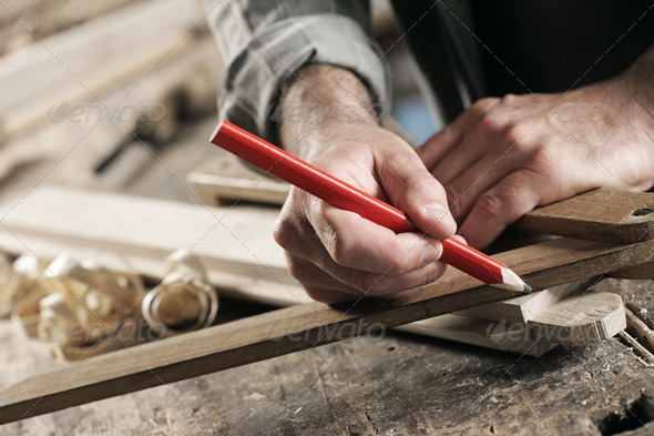 Carpenter Marking a Wooden Plank - Stock Photo - Images