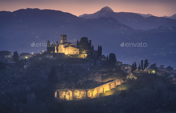 Barga town and Alpi Apuane mountains in winter. Garfagnana, Tuscany, Italy. - Stock Photo - Images
