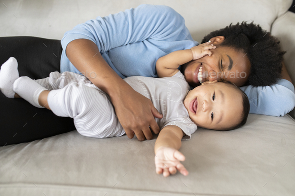 Happy multiethnic family spending time together in the new normal - Stock Photo - Images