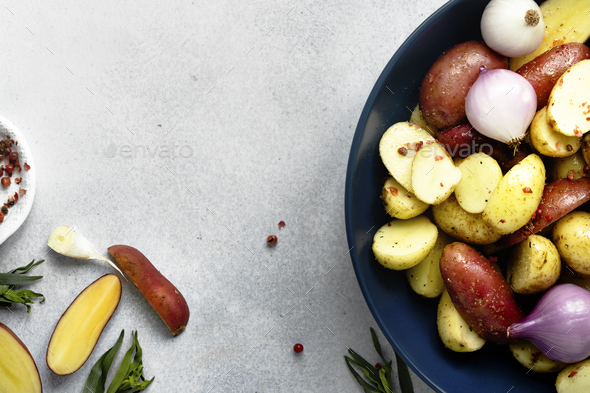 Mixed roasted potatoes with red onions food photography - Stock Photo - Images