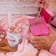 Close-up on woman's hands in pink pajamas opening a gift package. Christmas holidays concept - PhotoDune Item for Sale