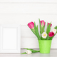 Empty white photo frame with tulip flower bouquet on table. Light rustic interior - PhotoDune Item for Sale