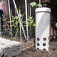 Worm tower with drilled holes placed in garden against plants - PhotoDune Item for Sale