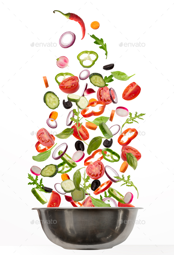 Fresh vegetables flying into cooking pot, isolated on white background - Stock Photo - Images