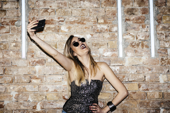 Woman taking selfie - Stock Photo - Images