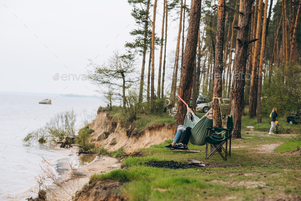 Couple Relaxing in a Hammock Overlooking the Water - Stock Photo - Images