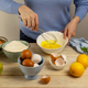 Woman cooking pie dough in the bowl and fruits - PhotoDune Item for Sale
