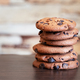 Stack of oatmeal cookies with chocolate on wooden table - PhotoDune Item for Sale