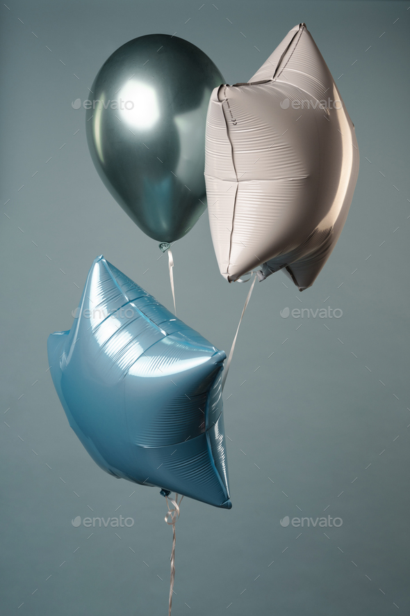 Photo of three balloons isolated over grey background - Stock Photo - Images