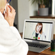 Close up of sick senior woman having video call with doctor - PhotoDune Item for Sale