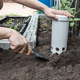 Person installing worm tower into soil in garden for organic composing - PhotoDune Item for Sale