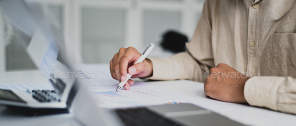Cropped shot of Accountant checking company data graph, auditing, data analysis. - Stock Photo - Images