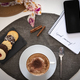 Above view of breakfast corner with a cup of cappuccino with milk froth and cocoa powder - PhotoDune Item for Sale