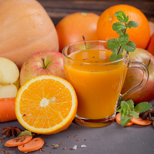 Fresh carrot, apple, pumpkin, orange, grapefruit on dark table. - Stock Photo - Images