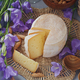 A head of fresh organic cheese served with bread, nuts and summer flowers. - PhotoDune Item for Sale