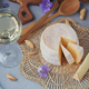 A head of fresh organic cheese served with nuts, white wine and summer flowers - PhotoDune Item for Sale