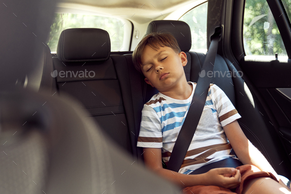 Boy sleeping while riding in car - Stock Photo - Images