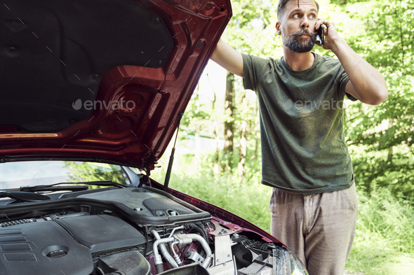 Serious man calling for help on the road - Stock Photo - Images